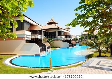 The luxury villas in Thai style hotel on Palm Jumeirah man-made island, Dubai, UAE - stock photo
