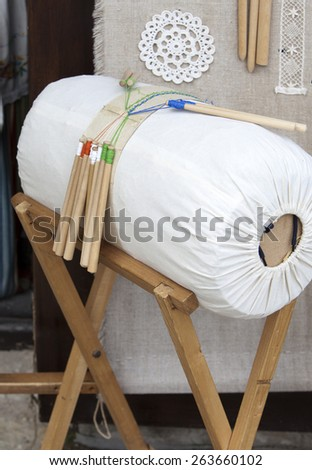 The machine for manual weaving of laces. - stock photo