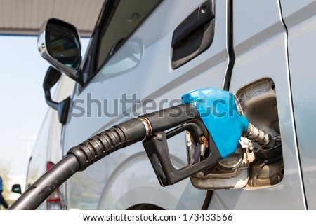 The machine with fuel fill with gasoline at a gas station - stock photo