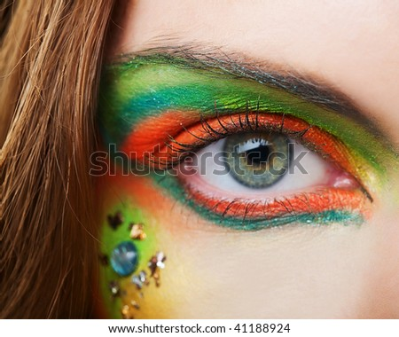 The macro beautiful female eye - stock photo