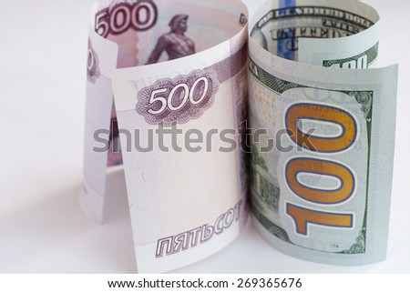 The macro european and russian money in the bills - stock photo