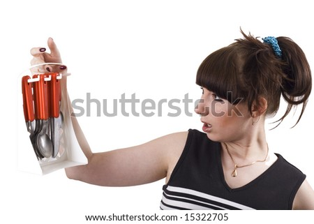 The mad housewife with knifes, spoons, plugs. funny picture