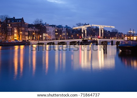 The Magere Brug (Skinny Bridge) on the Amstel river in the Netherlands - stock photo