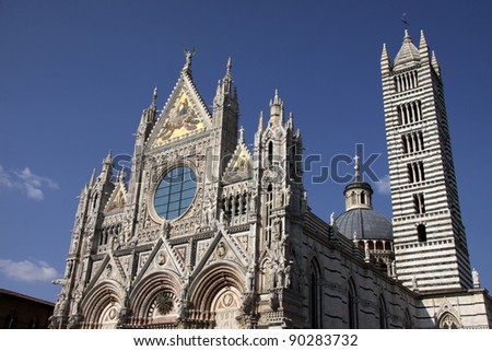 The magnificant cathedral of Siena (Duomo di Siena), shot in Siena, Italy.  The cathedral was constructed between 1215 and 1263. - stock photo