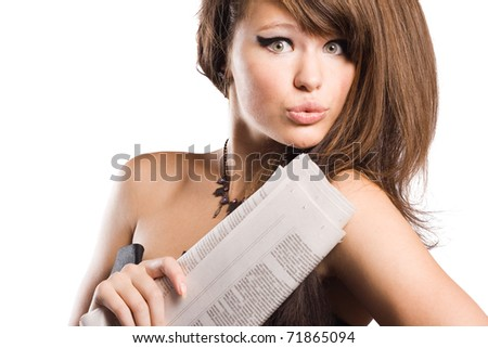 The magnificent business woman with the newspaper in hands. - stock photo