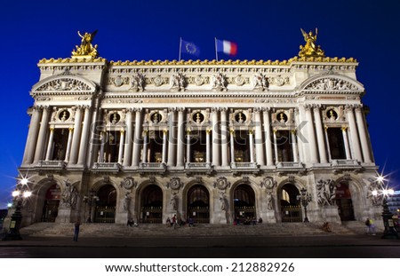 The magnificent Palais Garnier at dusk in Paris, France.  The Palais is a 1,979-seat Opera House built for the Paris Opera. - stock photo