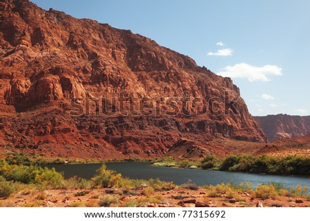 The magnificent river Colorado. A cool stream between mountains of red sandstone
