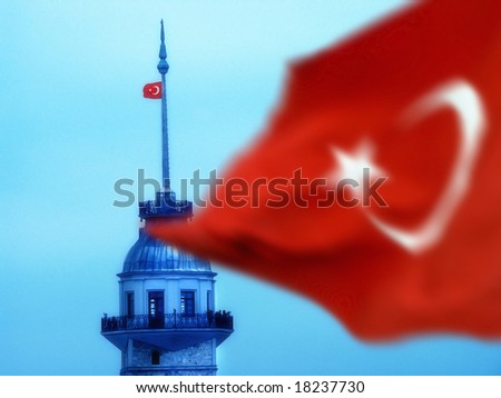 the maiden's tower and turkish flag in istanbul, Turkey - stock photo