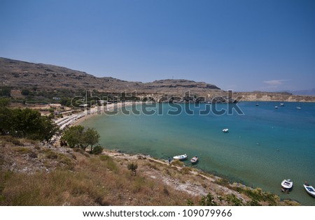 the main beach in the town of Lindos on the greek island of Rhodes.