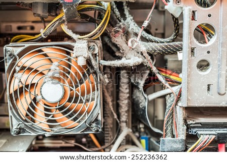 The main components of the outdated, dusty and non-working computer, clogged CPU fan - stock photo