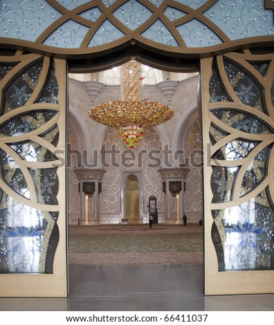 The main entrance door of Sheikh Zayed Mosque in Abu Dhbai, United Arab Emirates. The glass door with floral design - stock photo