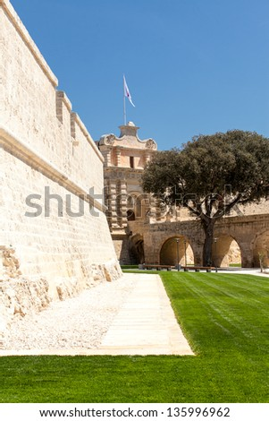 The main gate and newly restored bastion walls surrounding the medieval city of Mdina in Malta - stock photo