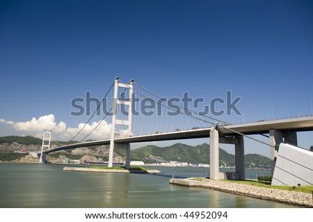 The main gateway to Hong Kong Airport - Tsing Ma Bridge - stock photo
