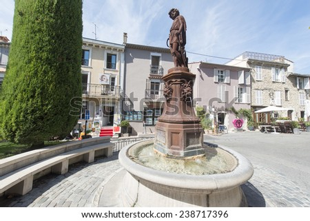 The main square in the centre of the Provence hilltop village Mougins, close to Cannes, is famous for it being the last place at which Picasso lived, and gourmet restaurants and art galleries. - stock photo