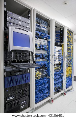 The mainframe and communication racks in data center for large organization