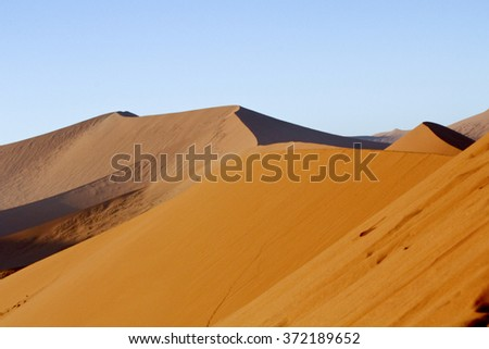 The majestic red dune. Shot in Deadvlei, Naukluft National Park and Namib desert, Namibia. - stock photo