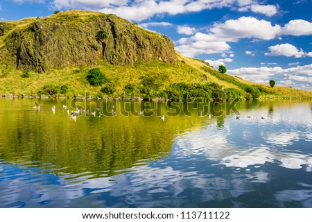 The majestic view of the mountains reflected in a lake - stock photo