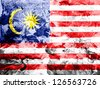 The Malaysia flag  painted dirty and grungy paper - stock photo