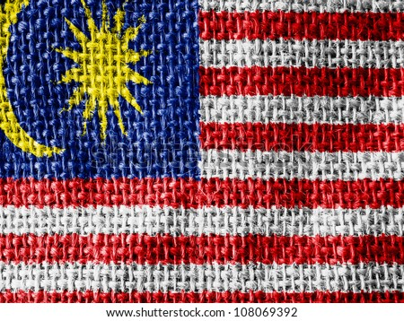 The Malaysia flag painted on fabric surface - stock photo