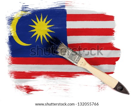 The Malaysia flag  painted with brush over it