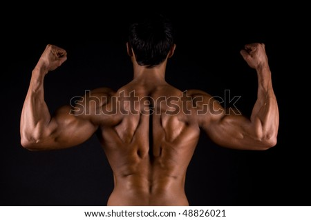 The male body on black background.