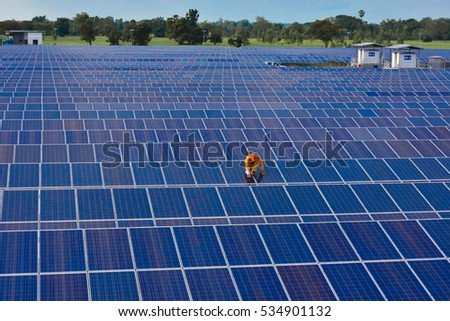 The male employee maintenance panels collect solar energy.