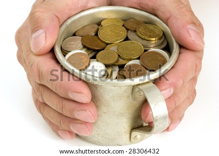 The Male hands and aluminum mug with money.