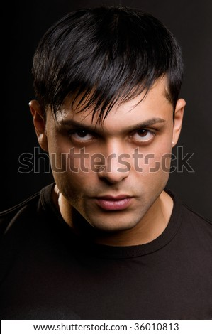 The male portrait in low key. - stock photo
