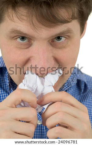 The man a chewing white sheet of paper