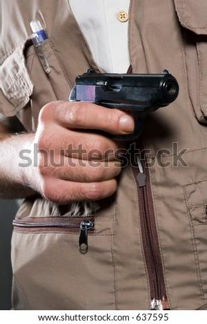 The man a holding pistol on alertness - stock photo