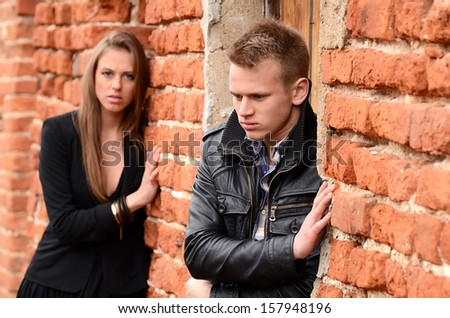 The man and woman against a wall - stock photo