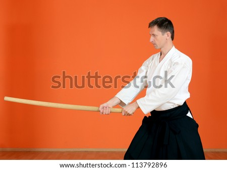 The man carries out exercises aikido - stock photo