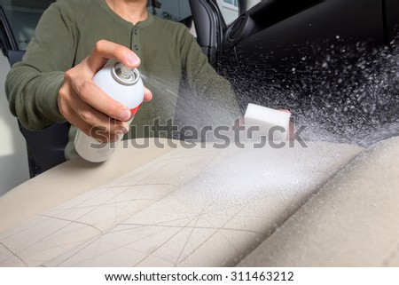 the man cleaning the car seat - stock photo