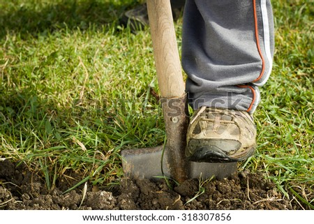 The man digging spring soil with shovel. Close-up - stock photo