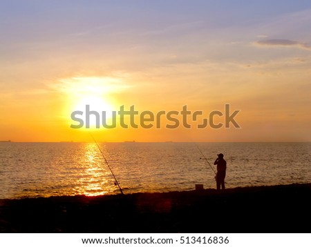 The man fishing at sea have sunset light style
