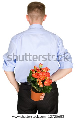 The man hides a beautiful flower behind a back - stock photo