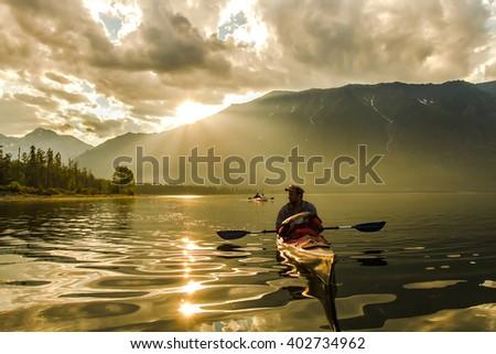 The man in a kayak on Lake Baikal - stock photo