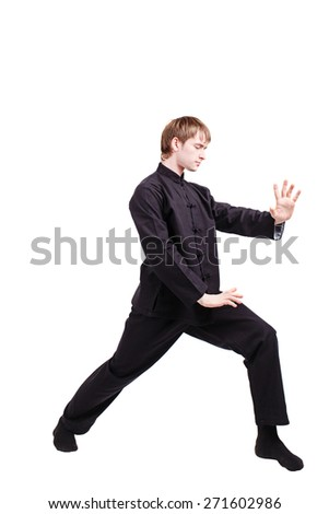 The man in a kimono practicing kung fu. Master rack the single pushing hand. Fighter isolated on white background. Concept of healthy life and martial arts. - stock photo
