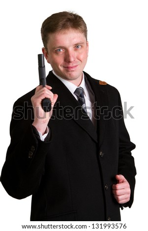 The man in a suit aims from a pistol. Isolated object.