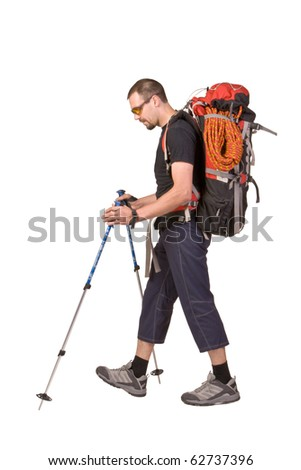 The man in sportswear with backpack and sticks isolated on white background - stock photo