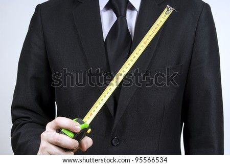 The man in the hand is holding a measuring instrument mm - stock photo