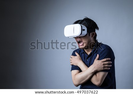The man is wearing a head mounted display, games, excitement, Fear, horror, horror content