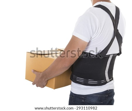 The man lifts a cardboard box wearing back support belt for protect body - stock photo