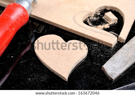 the man made heart shape from plank - stock photo