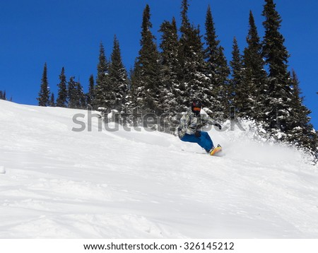 The man on a snowboard quickly goes from mountain. A mounting skiing resort of Sheregesh