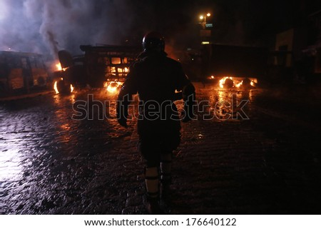The man on the background of burning police buses. Kyiv, Ukraine, January 19, 2014