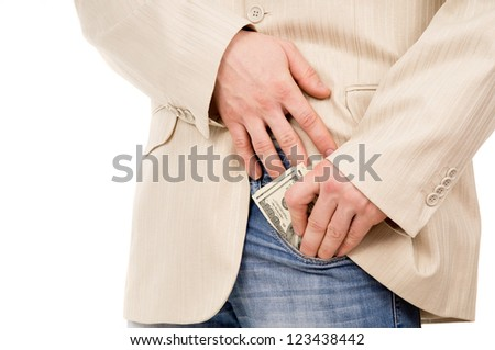 the man puts the money in his pants pocket isolated on white background - stock photo