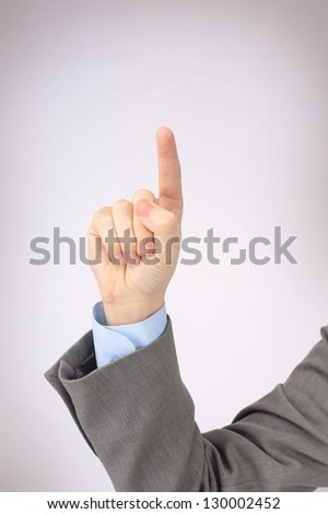 The man's hand shows a symbol - stock photo