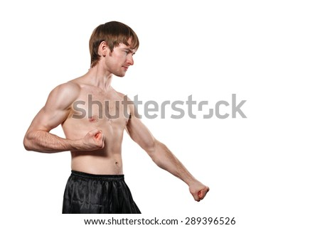 The man trains kata taekwondo. Isolated on white background. The concept of masculine strength and a healthy lifestyle.