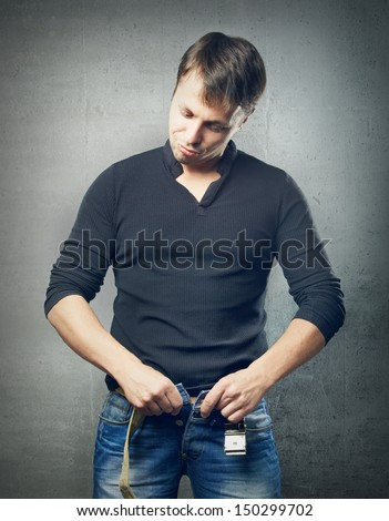 The man unzip jeans, the surprised look - stock photo